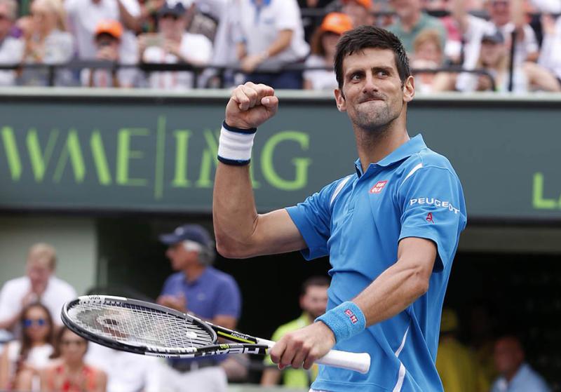 Novak Djokovic, of Serbia, celebrates after defeating Kei Nishikori, of Japan, 6-3, 6-3, during the men's singles final match at the Miami Open tennis tournament, Sunday, April 3, 2016, in Key Biscayne, Fla. (AP Photo/Wilfredo Lee)