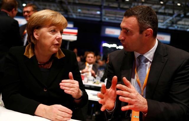 German Chancellor and leader of Germany's Christian Democratic Union (CDU) Angela Merkel (L ) talks to Ukrainian boxing World Champion and politician Vitali Klitschko during the CDU's annual party meeting in Hanover, December 4, 2012. Merkel was re-elected leader of her conservative Christian Democrats (CDU) on Tuesday with a record 97.9 percent of delegate votes, a strong sign that her party is unified behind her ahead of next year's federal election. REUTERS/Kai Pfaffenbach (GERMANY - Tags: POLITICS SPORT) Picture Supplied by Action Images