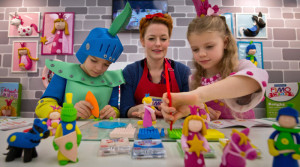 MUNICH, GERMANY - JANUARY 28:  TV-host Enie van de Meiklokjes and the two children Amalia and Leopold show how to play with 'FIMO kids form and play'-sets at the exhibition stand of 'Staedtler' during the Press-Preview of the Nuremberg International Toy Fair 2014 (Nuernberger Spielwarenmesse) on January 28, 2014 in Nuremberg, Germany. The Nuremberg International Toy Fair 2014 is the worlds biggest toy fair and is open to visitors from January 29 to February 3. (Photo by Joerg Koch/Getty Images)